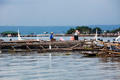 Fishing structures and villagers, Lake Taal, Talisay, Batangas, Philippines