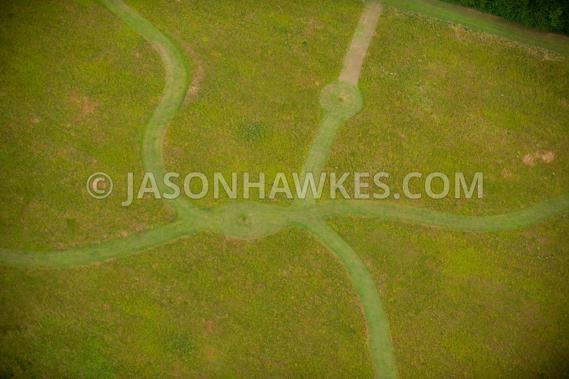 grass field aerial. aerial view of pathways through grass field i