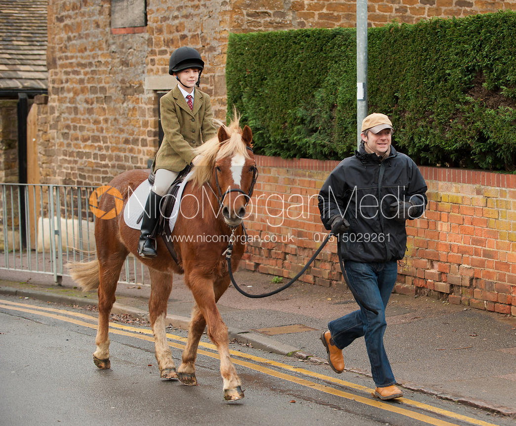 Members of the Cottesmore Hunt field move out of Oakham towards Ashwell