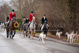 Huntsman Neil Coleman leads the Cottesmore Hunt hounds out of Oakham.
