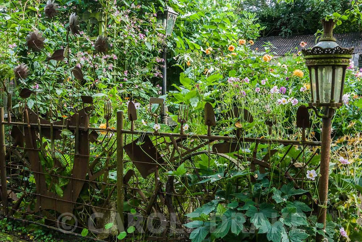 Fence Made Using Old Garden Tools. The Secret Garden At Serles House,  Wimborne,