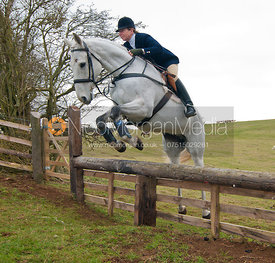 Clare Bell - Cottesmore Hunt followers jump a hunt jump near Somerby