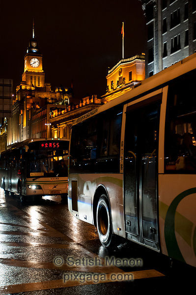 Buses and Clock Tower at the Bund, Shanghai.