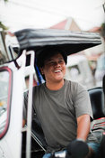 Man smiling sitting in motorcycle taxi, Tagaytay, Batangas, Philippines