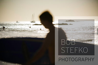 Man with surf board on Barcelo Langosta Beach, Tamarindo, Costa Rica
